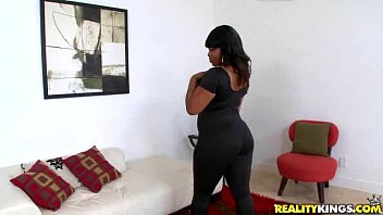 Horny black chick with big boobs and booty makes a hot striptease outdoor