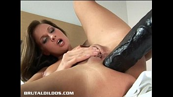Sexy brunette babe filling her huge asshole with a massive dildo